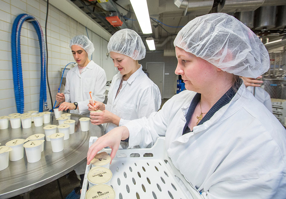 Student of food sciences work work in the milk processing plant.